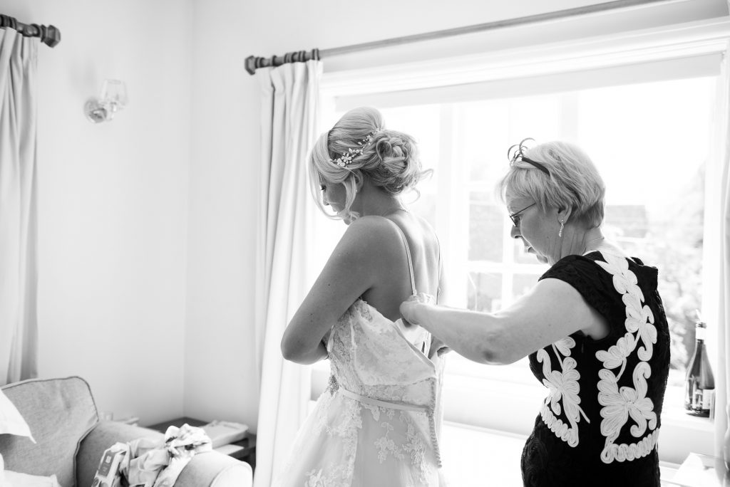 Mum helping bride wedding morning prep
