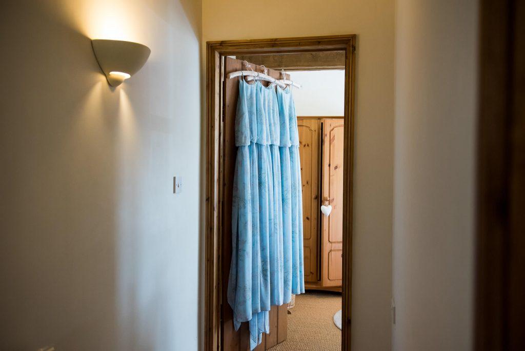 Hanging pastel blue bridesmaid dresses Norfolk Barn Wedding