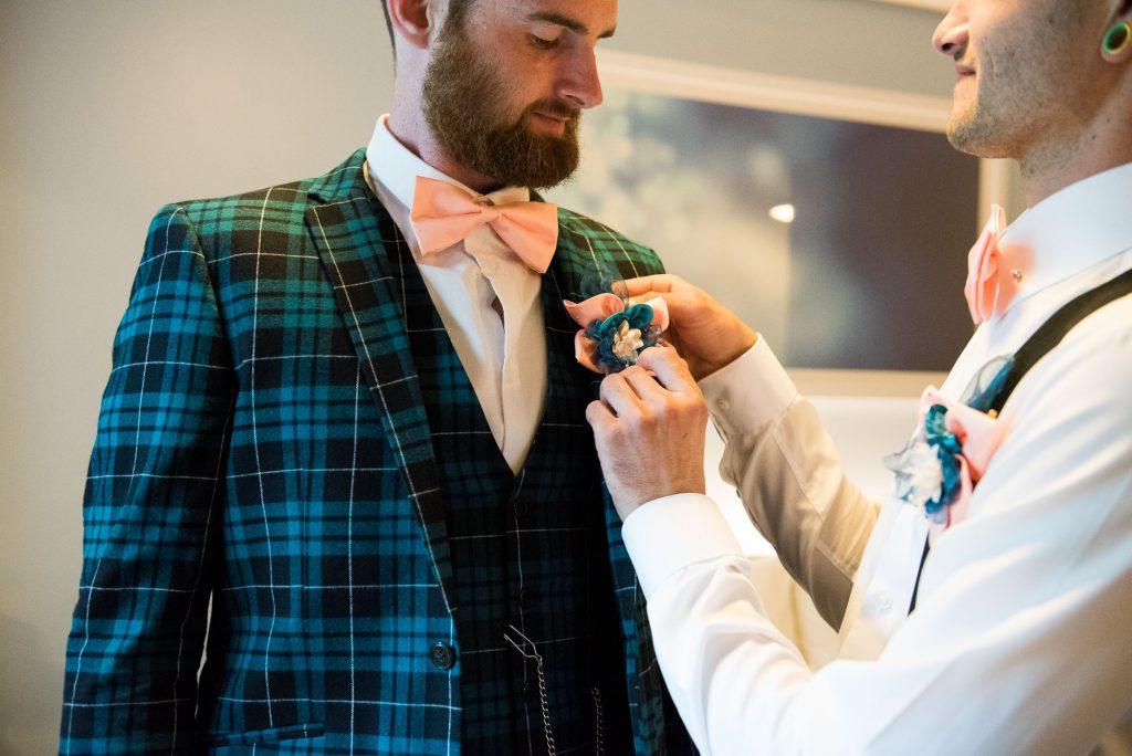 Creative groom wearing tartan suit quirky wedding