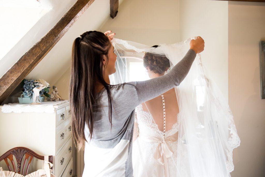 Jay West Bride pre wedding prep with flowing veil Norfolk