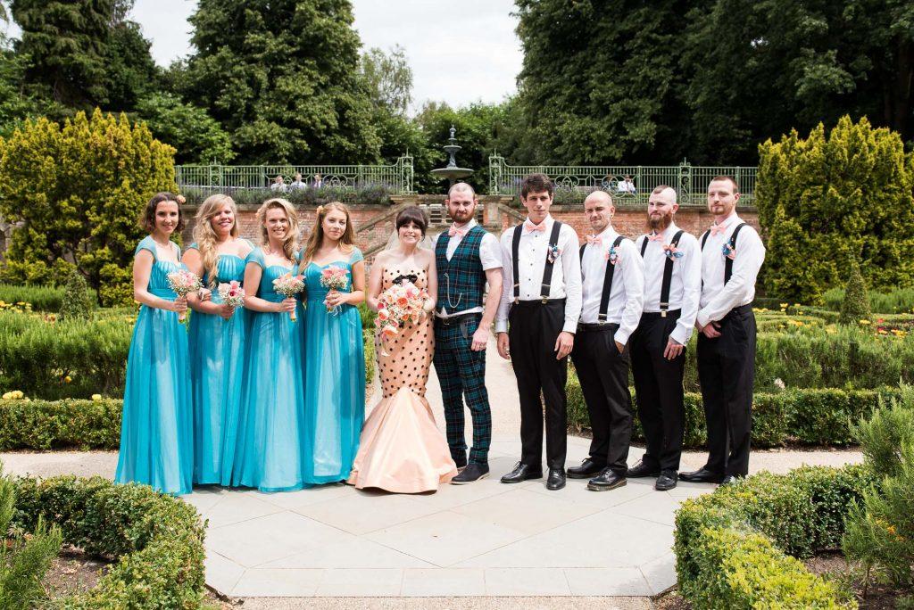 Punk inspired wedding - Whirling Turban bride with tartan dressed groom group wedding portrait Berkshire