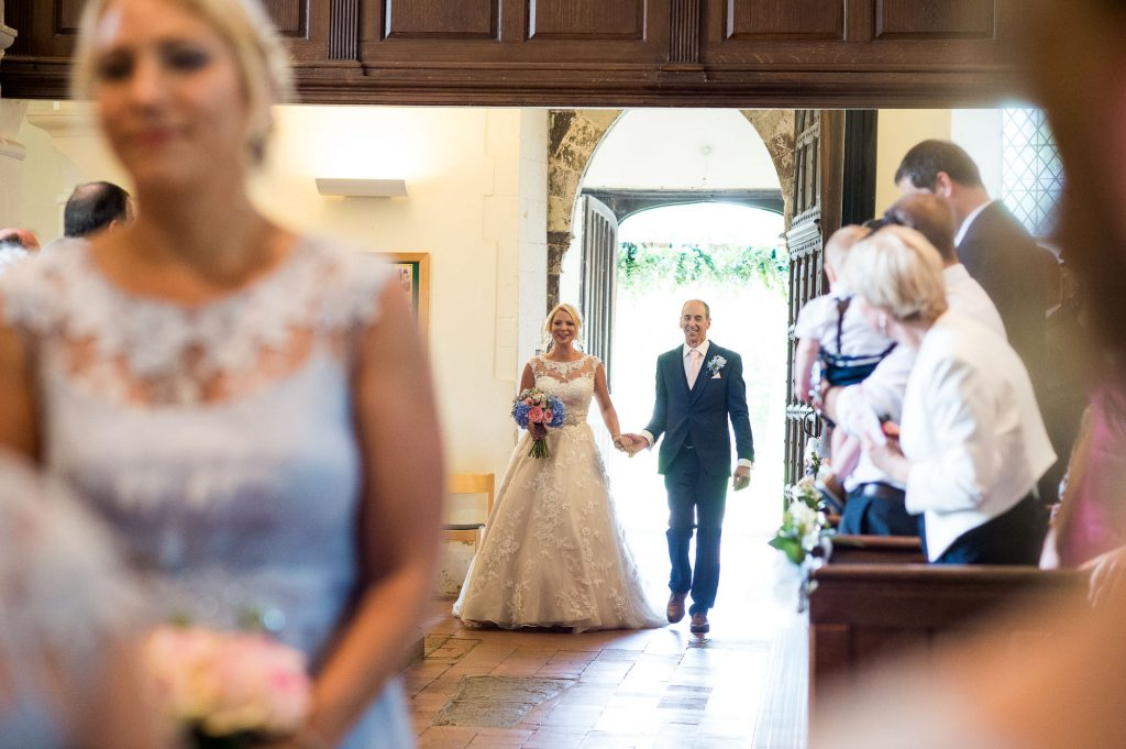 Ronald Joyce bride walks with Father church wedding ceremony