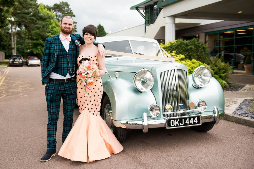 Whirling Turban bride with groom next to vintage car Berkshire