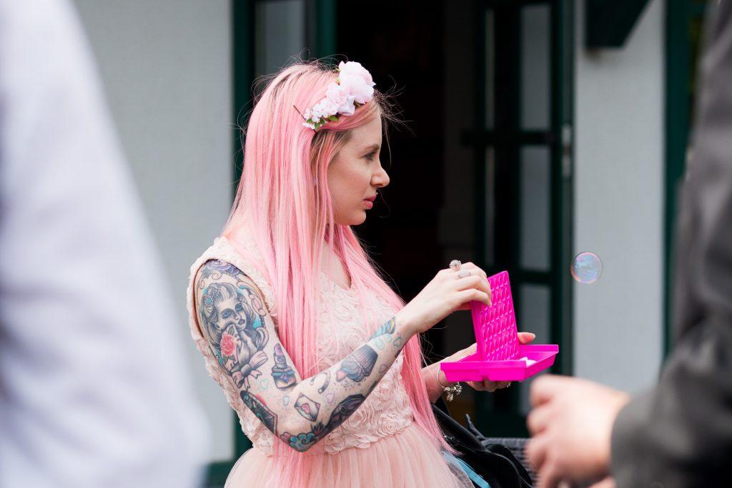 Punk inspired wedding - Pink haired tattooed wedding guest Wilde Theatre Berkshire