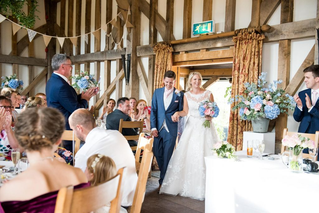 Natural countryside barn wedding with bunting