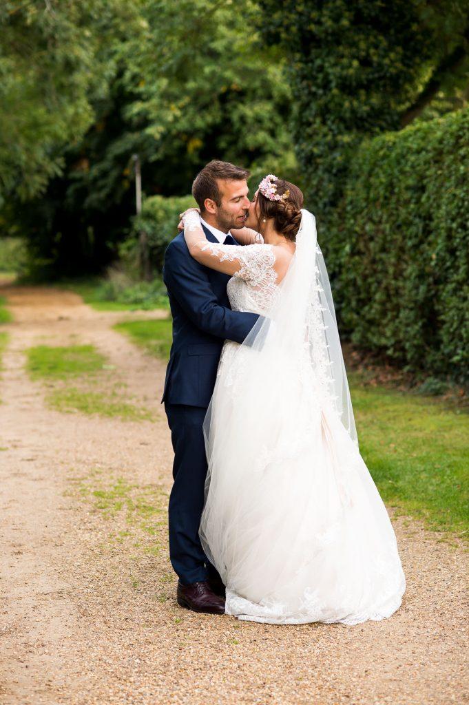 Norfolk wedding portrait bride wearing Jay West Bridal dress groom wearing Calvin Klein