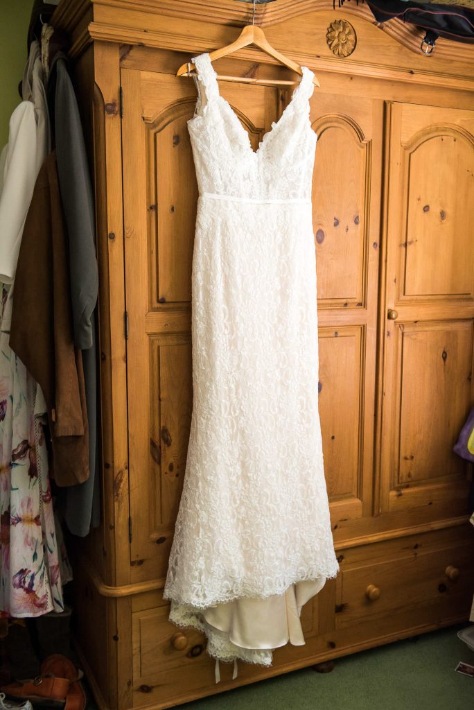 Hanging bridal dress Surrey Barn Wedding