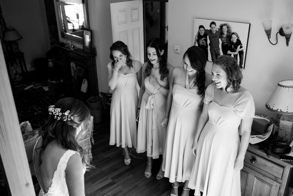 Black and white photograph of bridesmaids reaction to the brides first look
