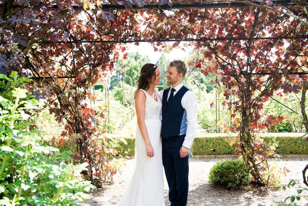 Beautiful Maggie Sotterro bride and stylish groom in vineyard