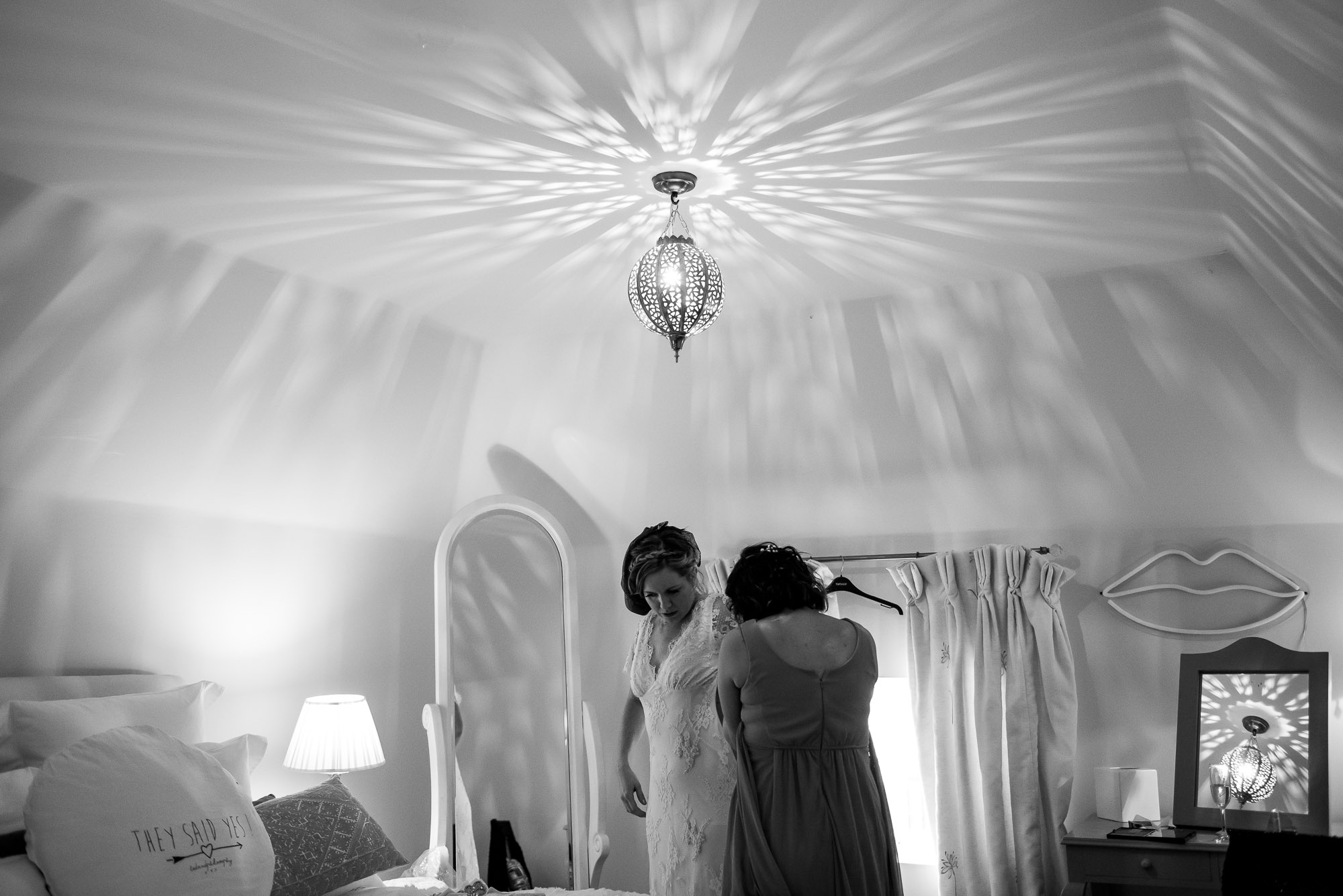 Bride getting changed into her wedding dress