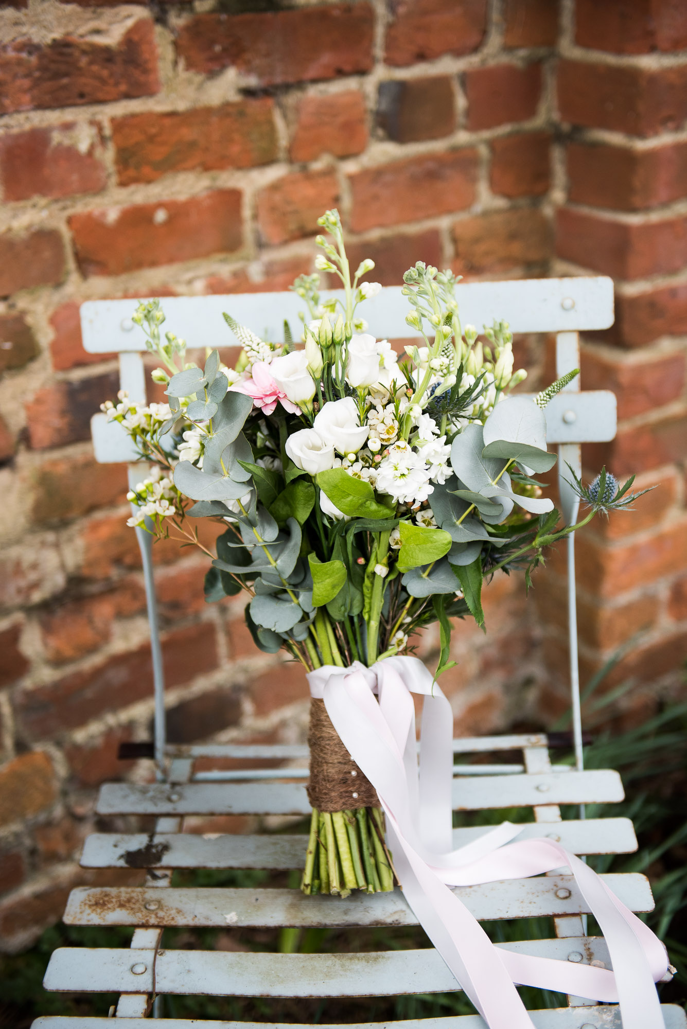 Bridal bouquet with eucalyptus and white flowers