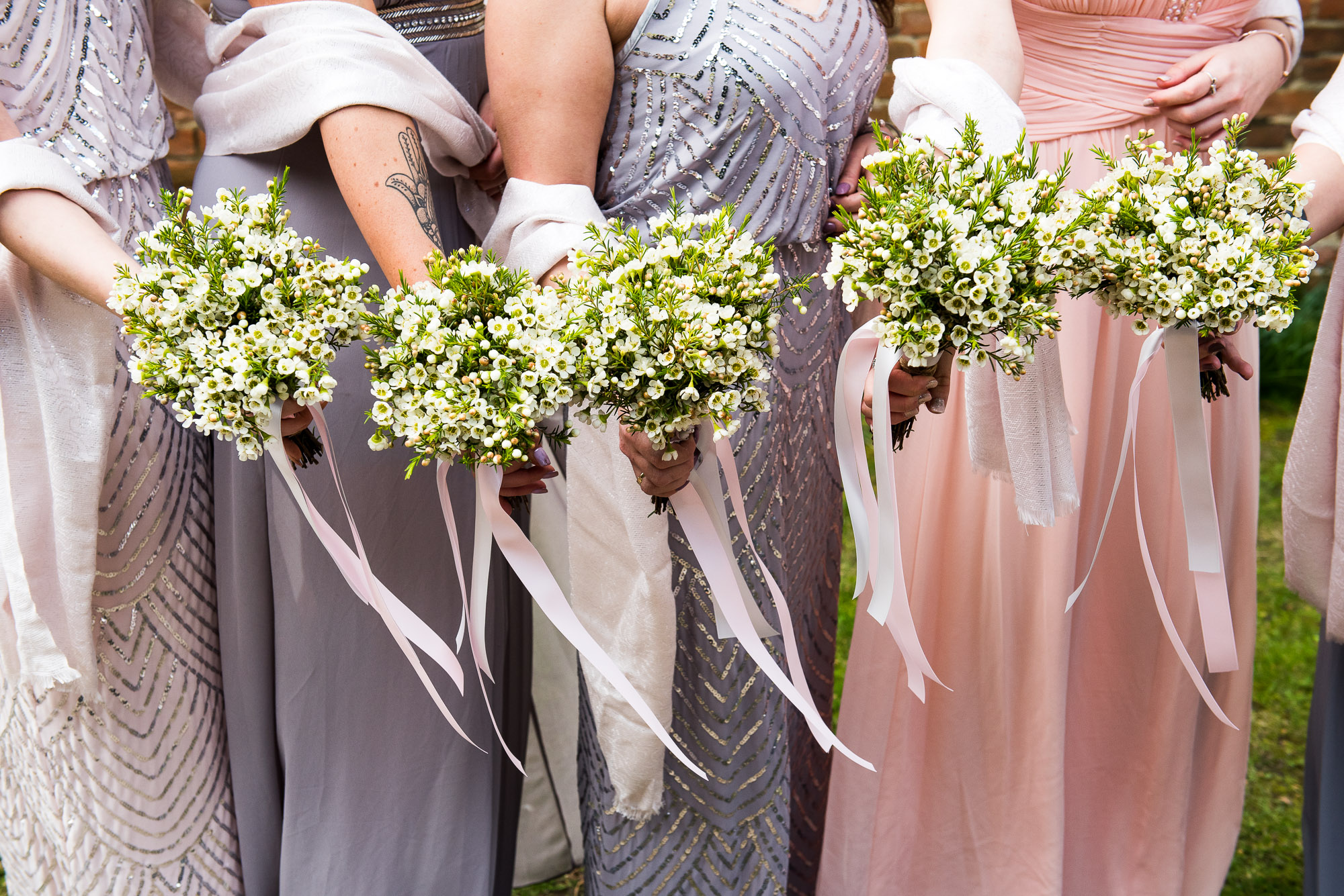 Wax flower bridesmaid bouquets