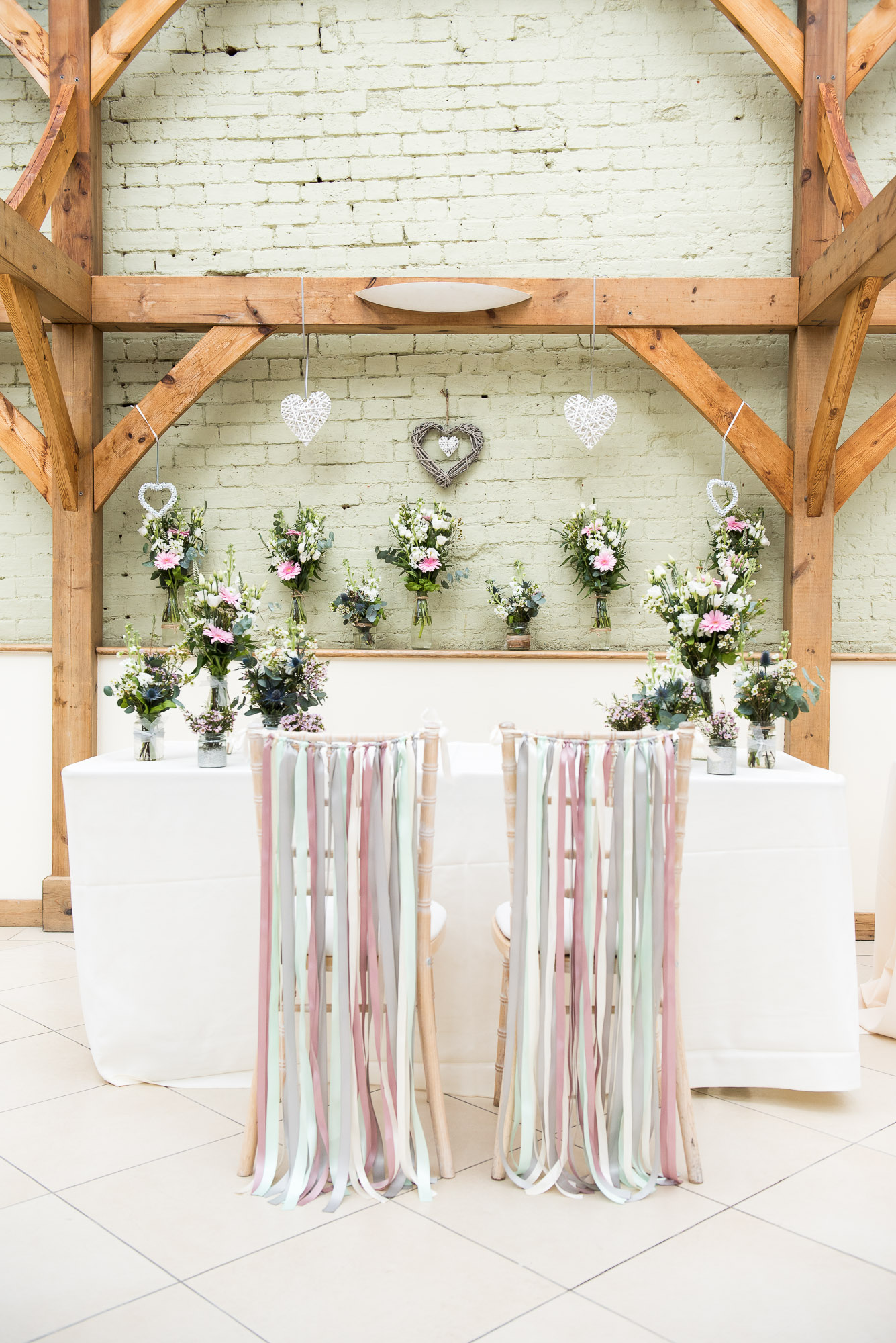 Chairs decorated with pastel coloured ribbons