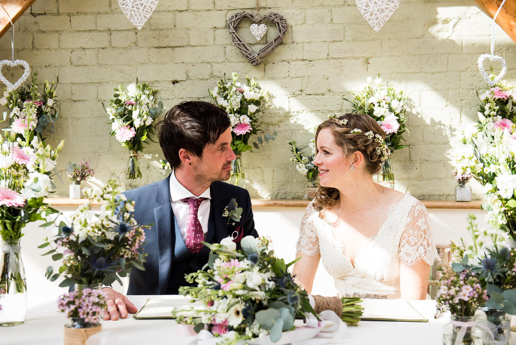 signing the register surrounded by flowers