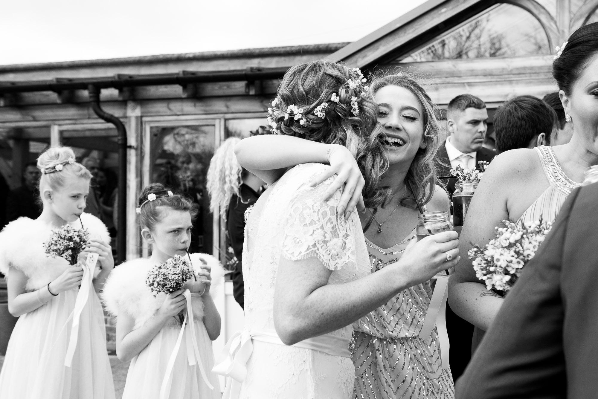 bridal party congratulating the bride