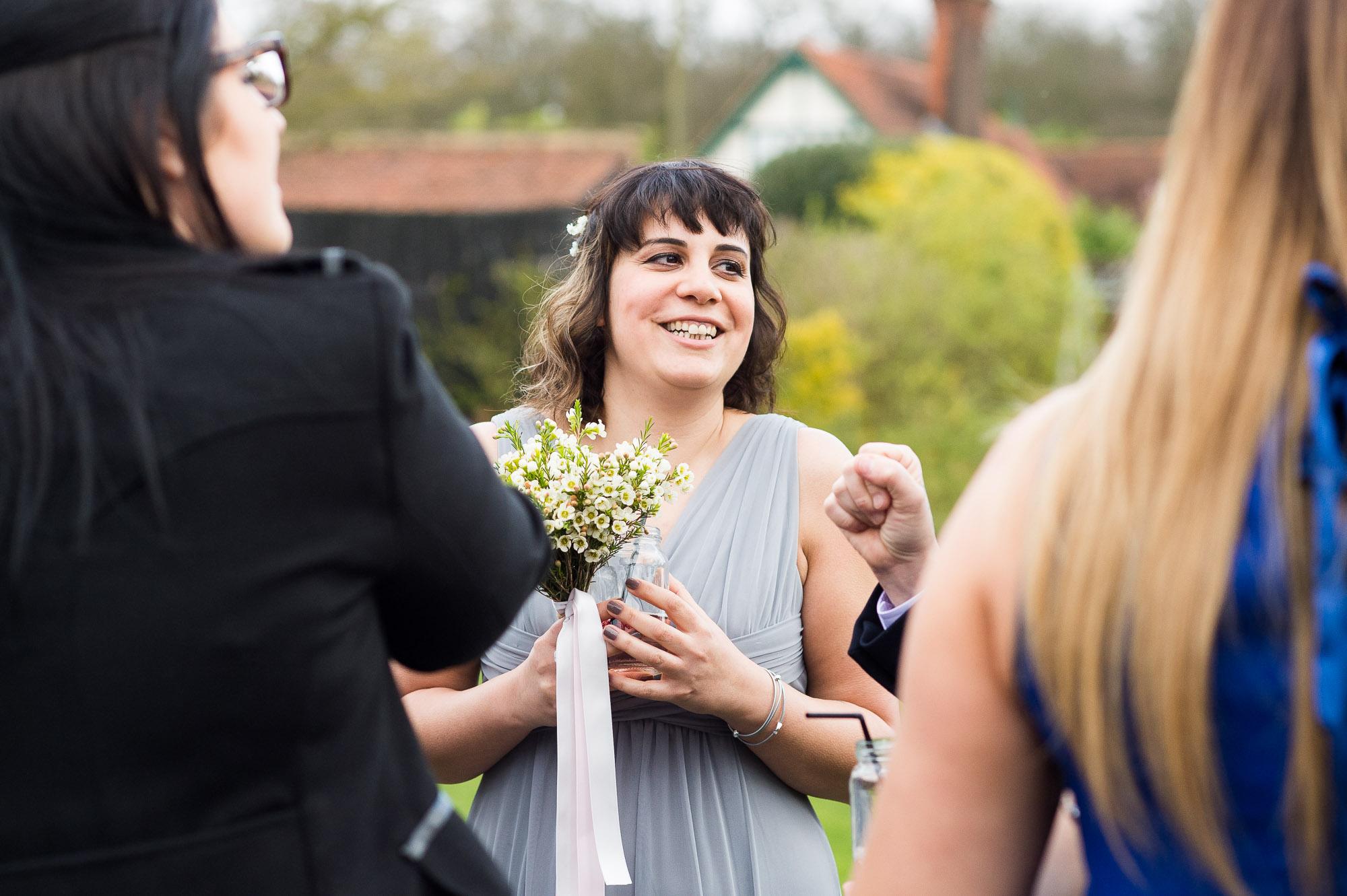 smiling bridesmaid at a Spring garden reception