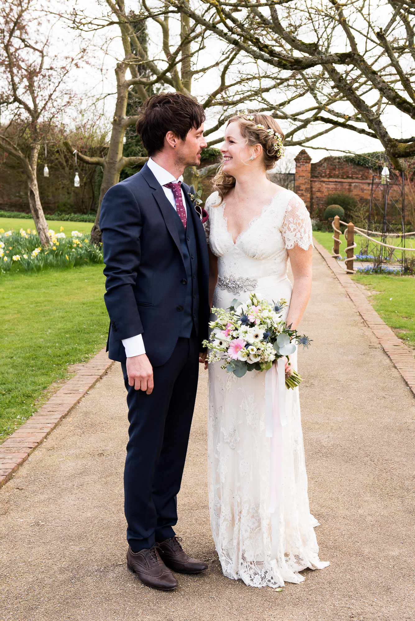 bride and from portrait in the gardens of Gaynes Park
