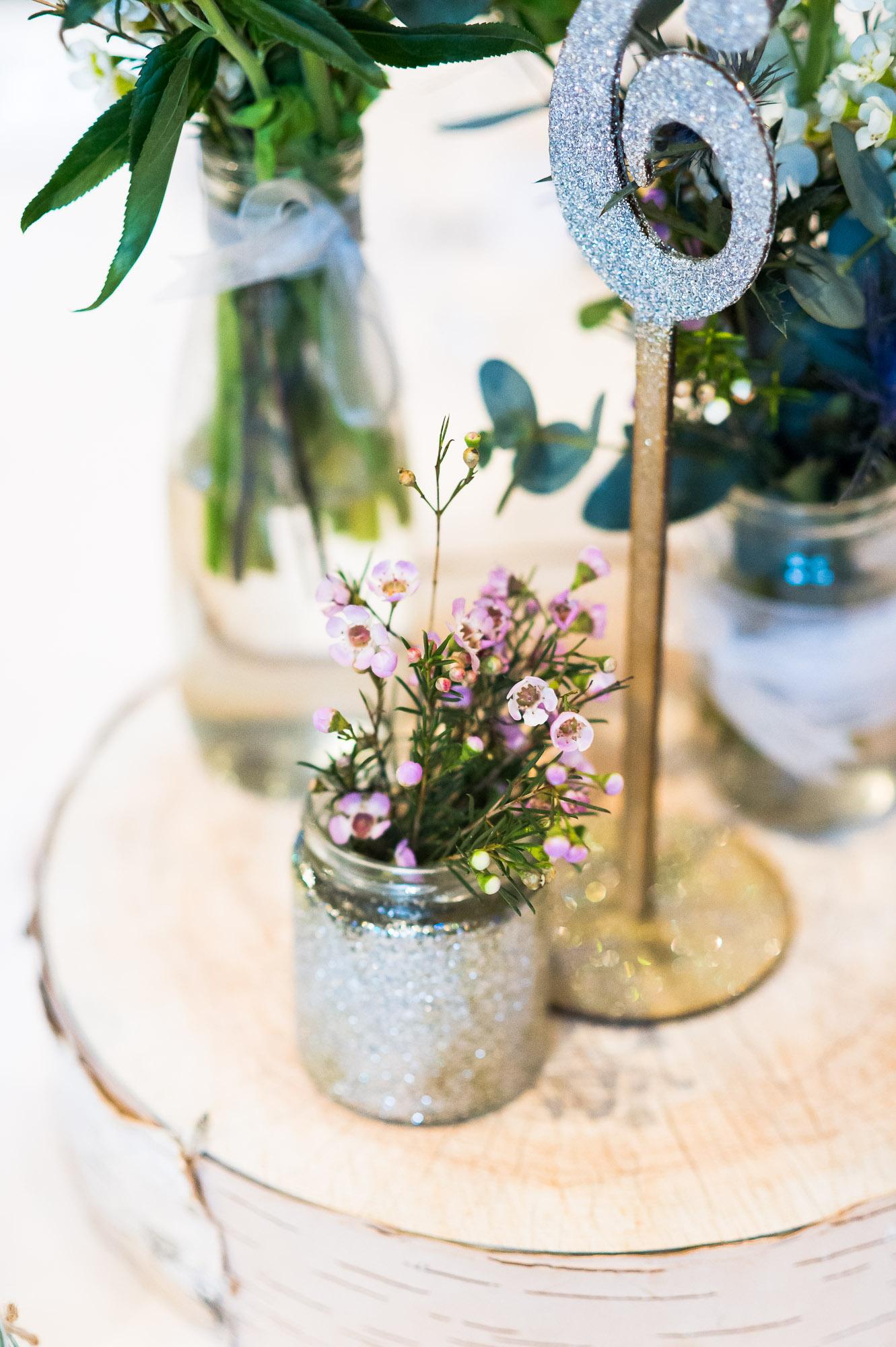 wax flower arrangement in glitter DIY bottle