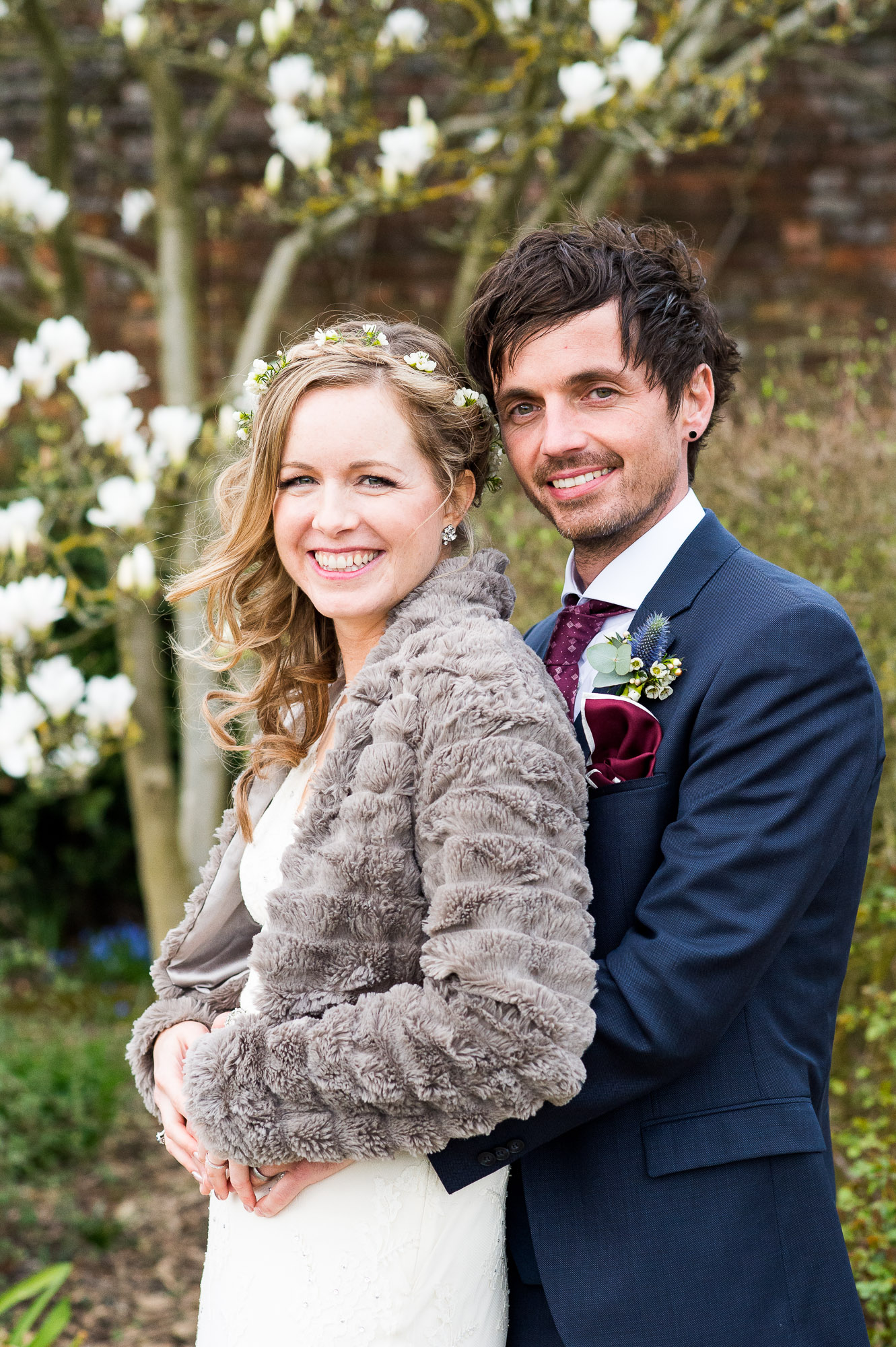 natural smiling bride with groom Essex Barn wedding