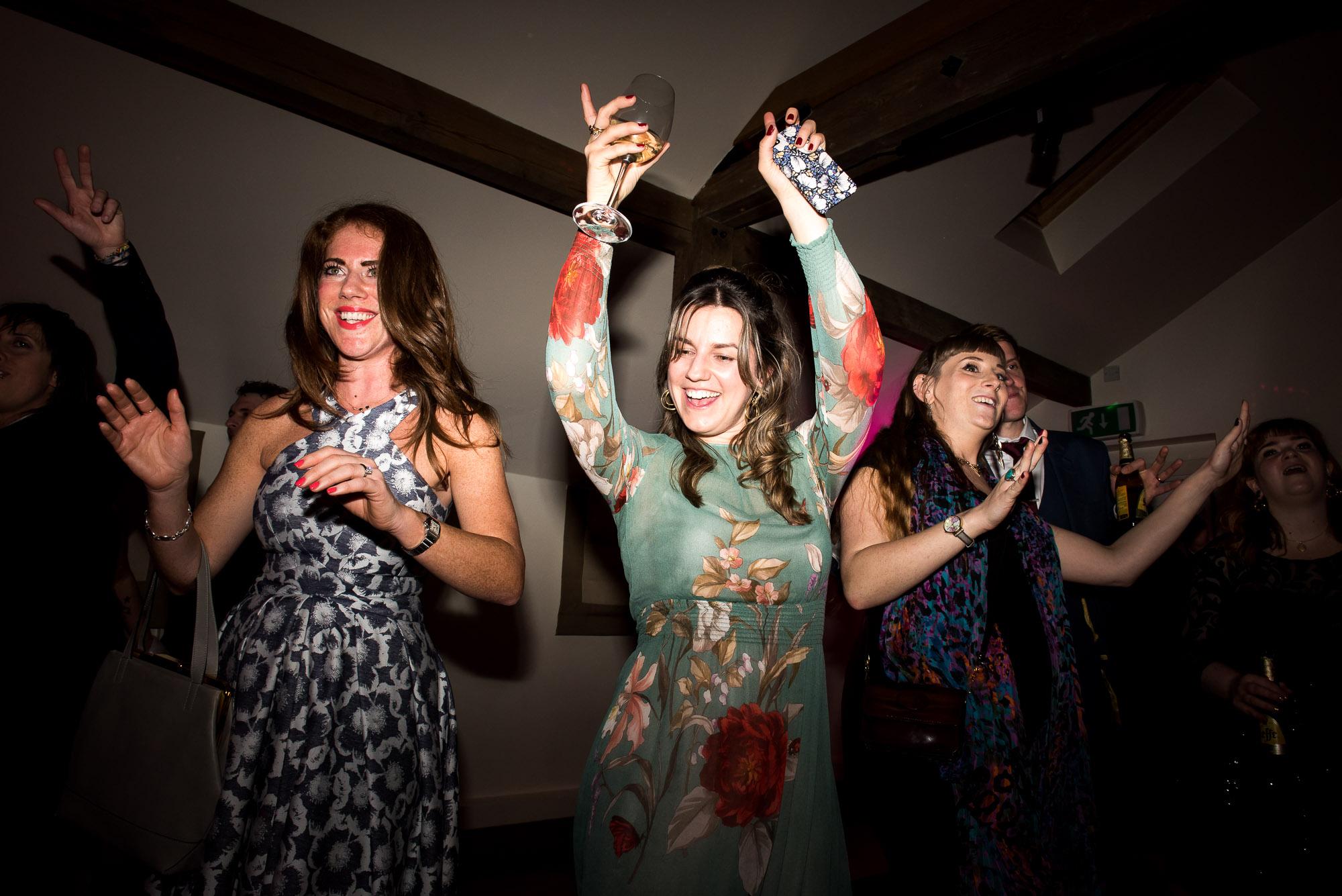 Ladies dancing Essex Barn wedding