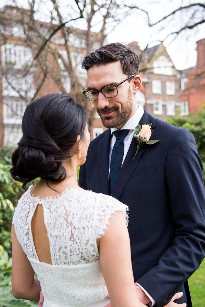 Bride and groom in navy blue suit London Wedding