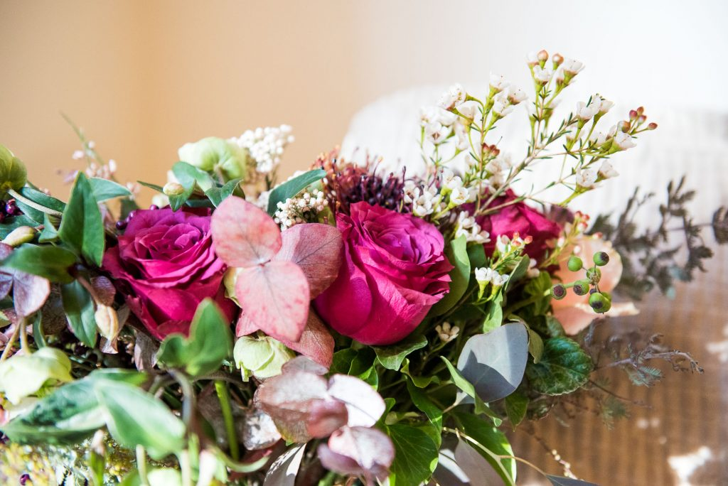 Ashridge House Wedding. Natural Wedding Photography. Bridal bouquet with winter blooms by Myrtle and Bloom.