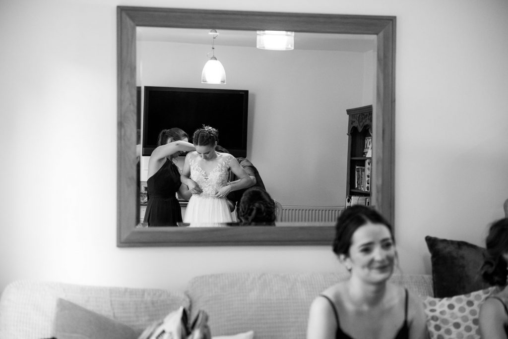 Ashridge House Wedding. Natural Wedding Photography. Bride reveals her dress for the first time.