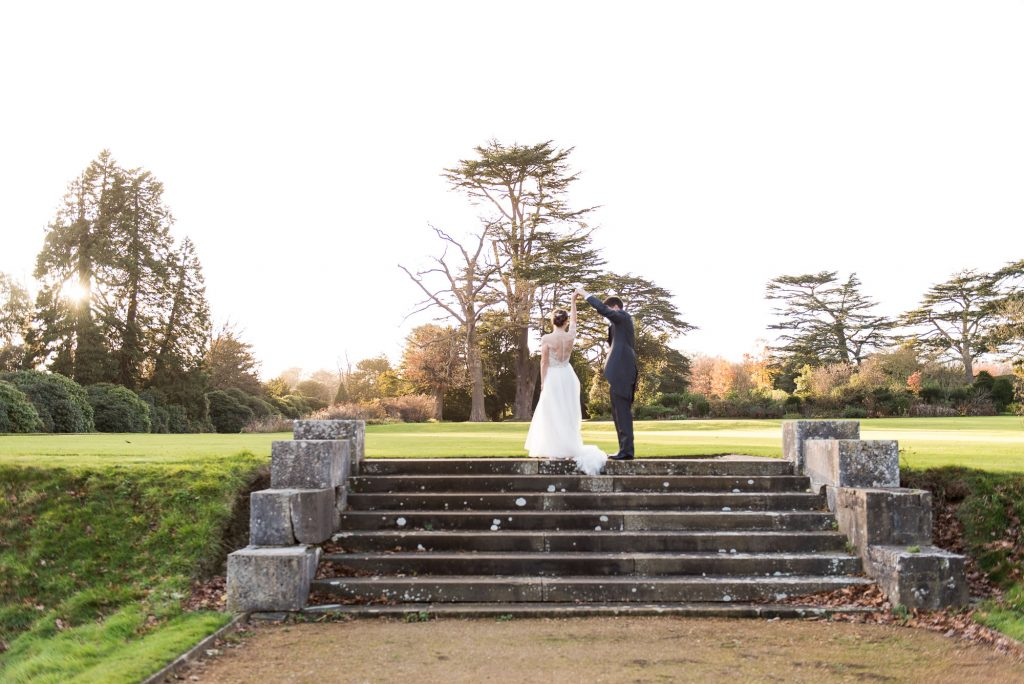 Ashridge House Wedding. Natural Wedding Photography. Bride and groom dance in the grounds of Ashridge House.