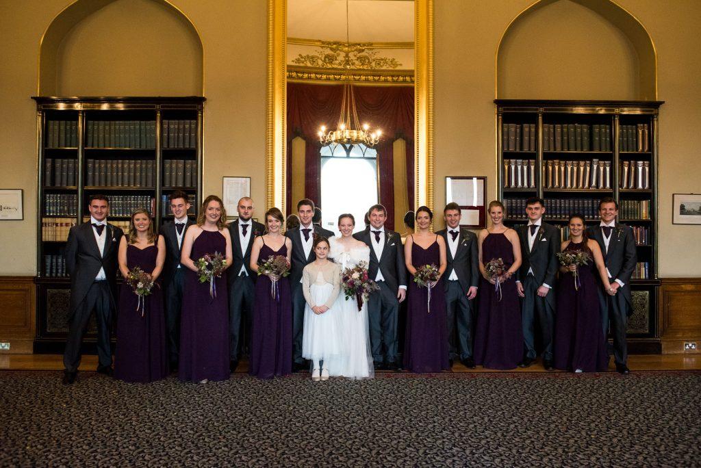 Ashridge House Wedding. Natural Wedding Photography. Bridal party with groomsmen at winter wedding in Ashridge House.