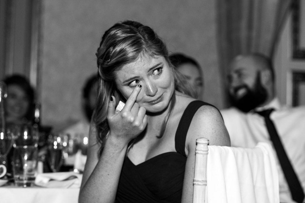 Ashridge House Wedding. Natural Wedding Photography. Emotional guest reactions to wedding speeches.