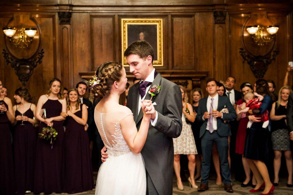 Ashridge House Wedding. Natural Wedding Photography. Couple enjoy their first dance together in the hall of Ashridge House.