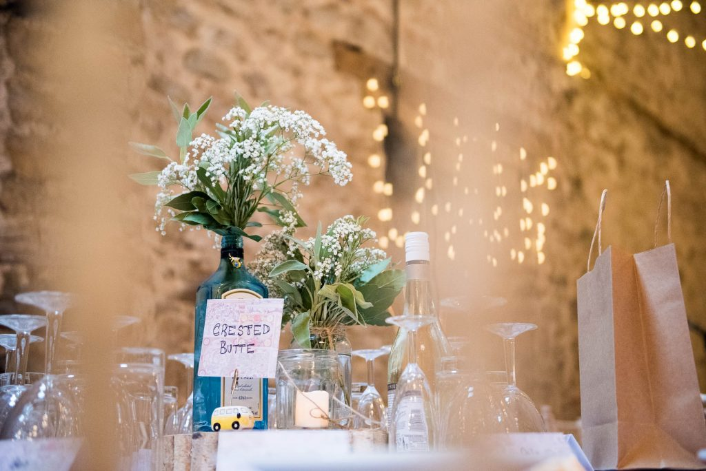 Park House Barn, Rustic Barn Wedding, Gin Bottle Centre Pieces Filled with Natural Herbs and Flowers