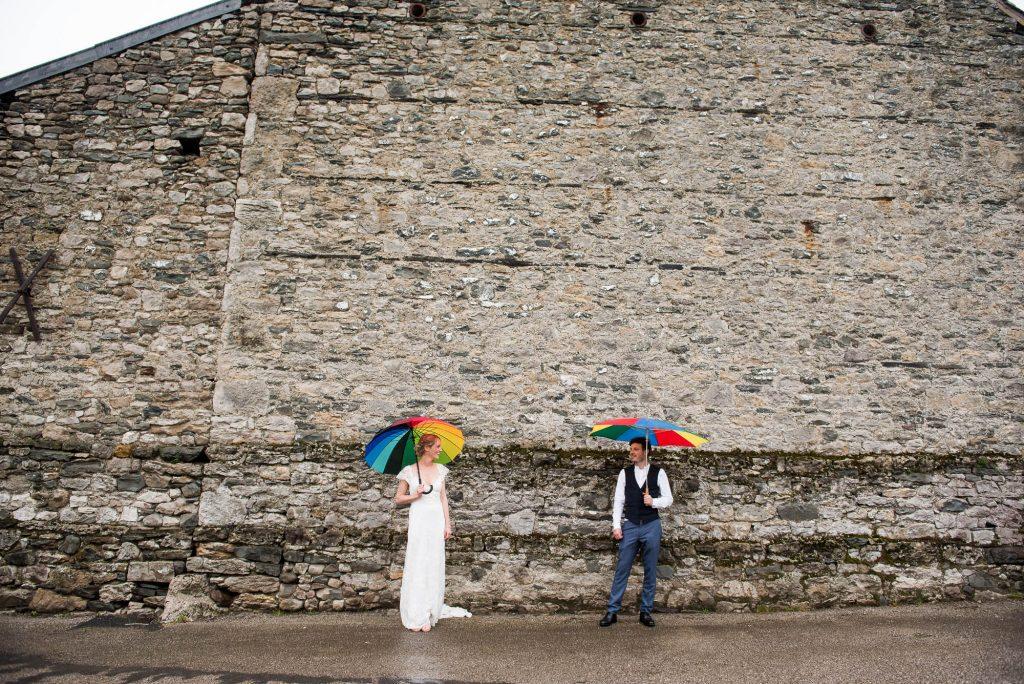 Park House Barn, Rustic Barn Wedding, Bride and Groom with Rainbow Umbrellas