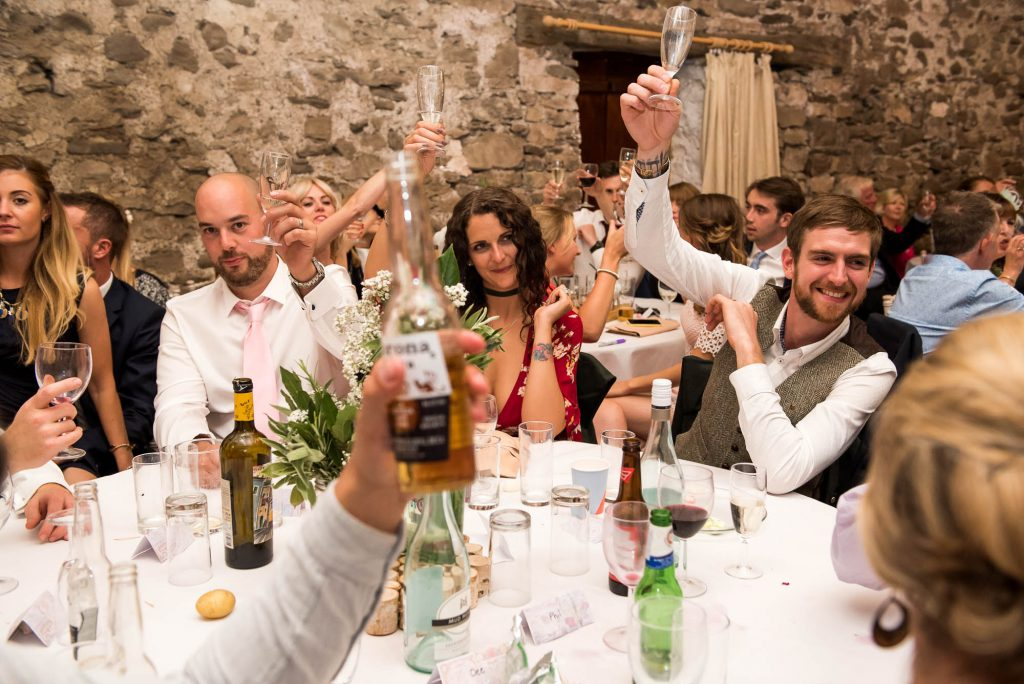 Park House Barn, Rustic Barn Wedding, Guests Cheers a Champagne Toast During Wedding Speeches