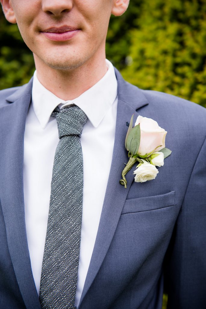 Great Fosters. Natural Wedding Photography. Natural Wedding Detail White Rose Button Hole.