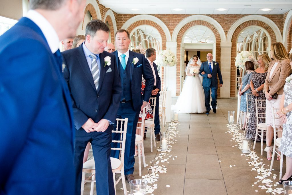 Great Fosters. Natural Wedding Photography. Emotional Reactions When the Bride Enters The Ceremony.