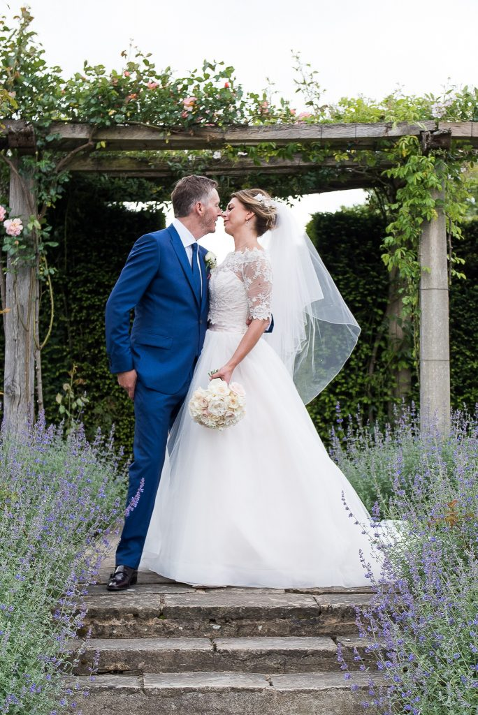 Great Fosters. Natural Wedding Photography Surrey. Wedding Portrait in The Lavender Garden.