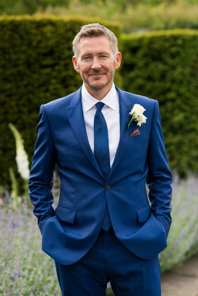Great Fosters. Natural Wedding Photography Surrey. Grooms Wearing Reiss Suit Wedding Portrait.