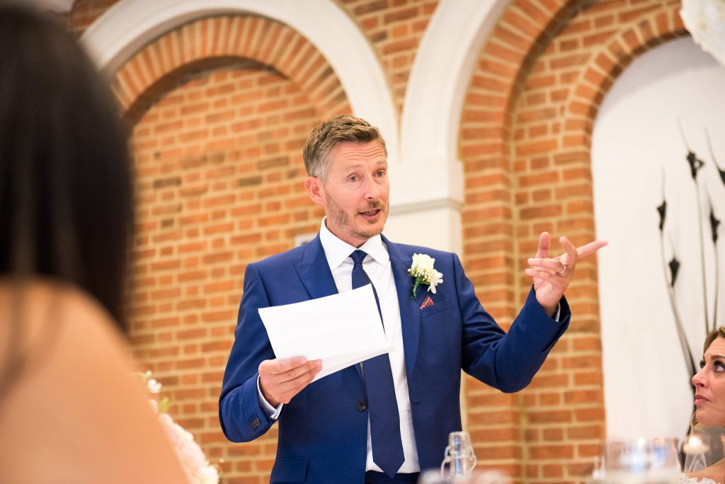 Great Fosters. Natural Documentary Wedding Photography, Surrey. The Groom Delivers a Funny Speech.