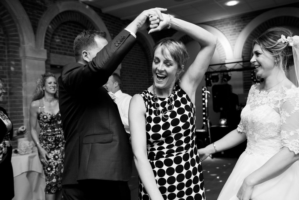 Great Fosters. Natural Documentary Wedding Photography, Surrey. Fun and Candid Dance Floor Photography.