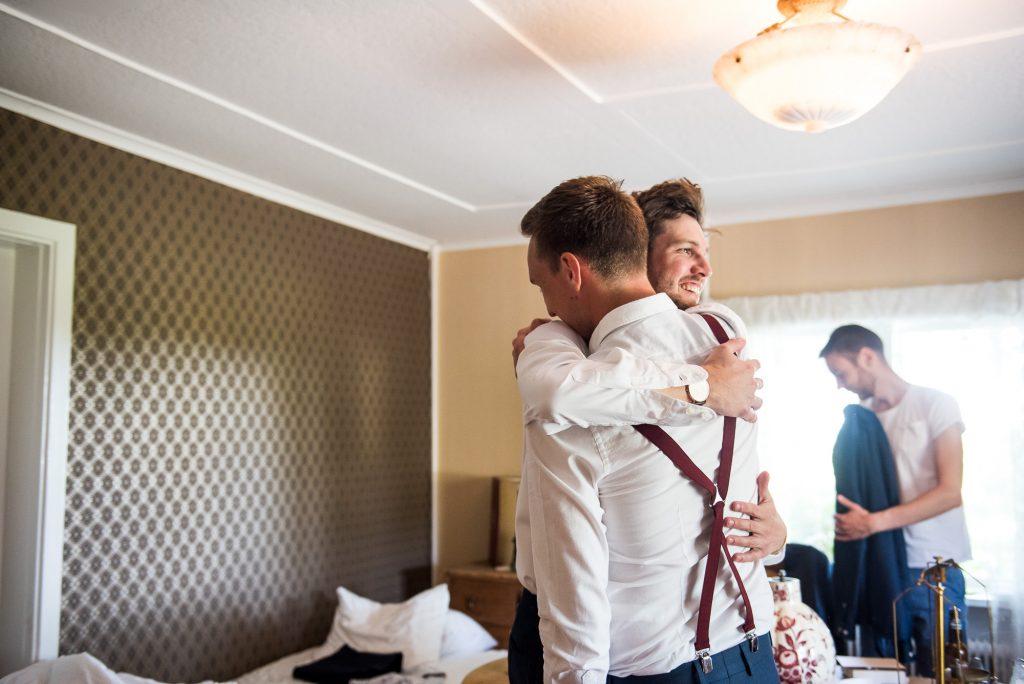 Swedish Wedding - Kroksta Gard Wedding - Candid Moment Between a Groom and Best Man