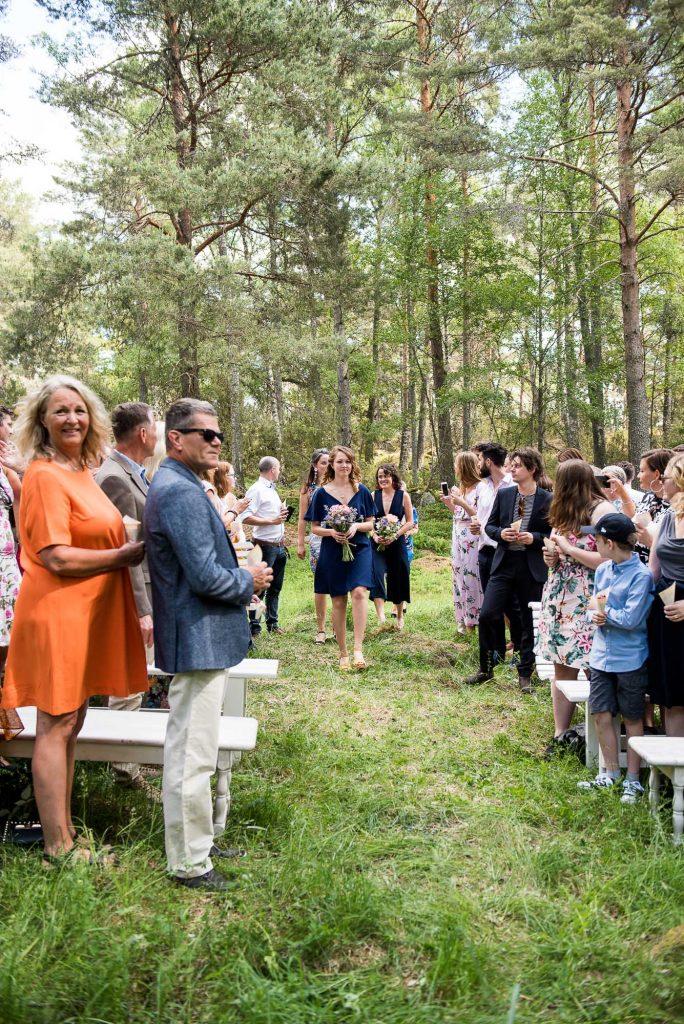 Destination Wedding Photography Sweden - Outdoor Ceremony photography - Bridesmaids enter outdoor wedding ceremony