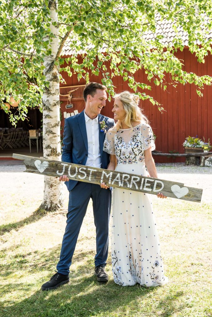 Swedish Wedding - Kroksta Gard Wedding - Natural and Cute Couples Portrait with Sign