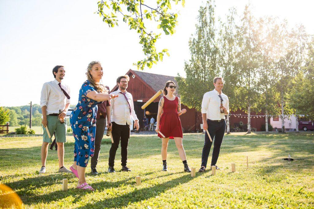 Swedish Wedding - Kroksta Gard Wedding - Guests Enjoying the Sunshine and Playing KUBB