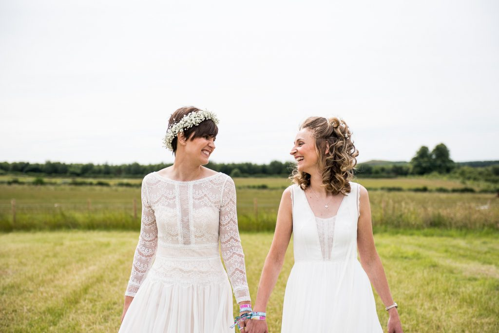 Relaxed Wedding Photography - Brides Walk Hand in Hand Smiling Together - LGBT Wedding