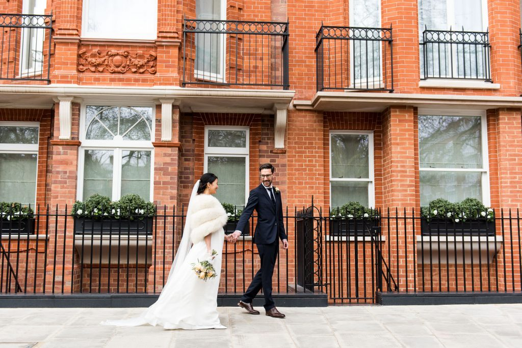 Relaxed Wedding Photography - Brides Walk Hand in Hand Smiling Together - London Wedding Photography