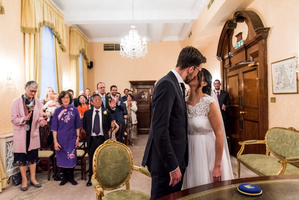 Wedding Day Timeline - Bride and Groom Share First Kiss at Registry Office - Outdoor Surrey Wedding