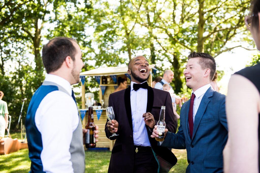 Wedding Day Timeline - Guests Enjoying Themselves and Laughing at Reception - Outdoor Surrey Wedding