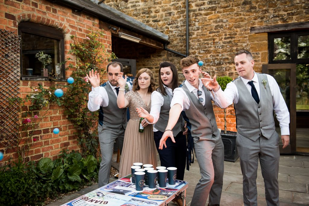 Wedding Day Timeline - Wedding Guests Play Beer Pong At Reception - Outdoor Surrey Wedding
