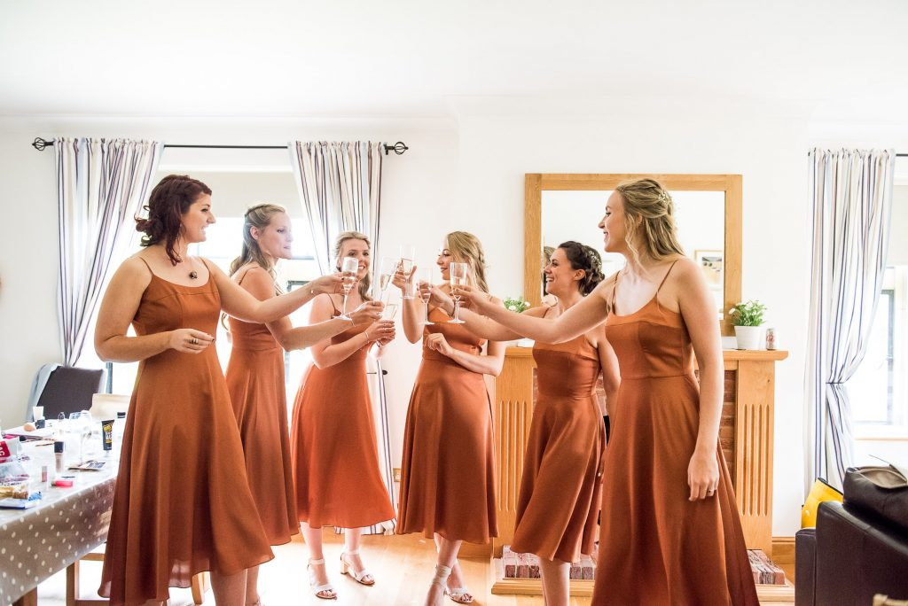 Bridesmaids Cheers with Champagne the Morning of The Wedding